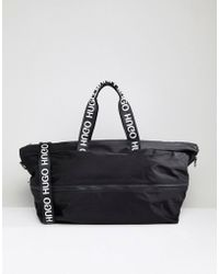 HUGO - Reverse Logo Nylon Holdall In Black - Lyst