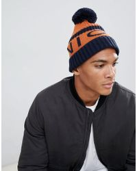 Nicce London - Nicce Bobble Hat In Orange With Logo - Lyst