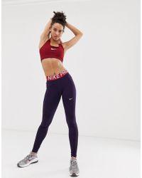 37e0bea1fa131 Nike Nike Plus Training Power Legging In Mint Colourblock in Black - Lyst