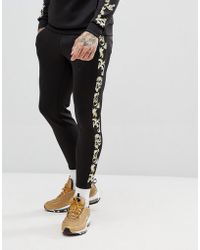 SIKSILK - Cropped Jogger In Back With Baroque Side Stripe - Lyst