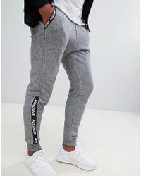 Hollister - Skinny Logo Tape Detail Cuffed jogger In Grey Marl - Lyst