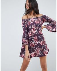 c844f4ece2 ASOS - Off Shoulder Mini Dress With Trumpet Sleeve In Floral Print - Lyst