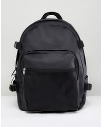 ASOS - Backpack With Internal Laptop Pouch In Black Rubberised Finish With Mesh Pocket - Lyst
