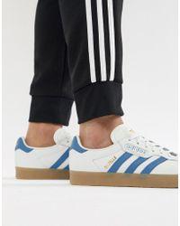 Lyst adidas Originals Stan Smith zapatillas en blanco con goma de mascar