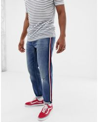 ASOS - Tapered Jeans In Mid Wash Blue With Red Side Stripe - Lyst