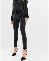 3a12de3f8739 ASOS - Whitby Low Rise Skinny Jeans In Washed Black With Lace Up Front  Detail -