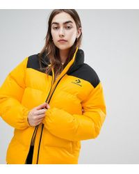 7f0b1ed62a16 Converse - Oversized Exclusive Yellow Padded Jacket - Lyst