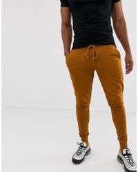 ASOS - Joggers skinny arancione scuro - Lyst
