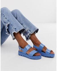 6518e479bbf ASOS Fadey Chunky Jelly Flat Sandals in Blue - Lyst
