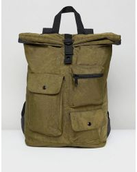 ASOS - Backpack With Roll Top In Washed Khaki And Multi Pocket Detail - Lyst