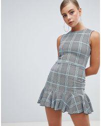 Missguided - Peplum Hem Mini Dress In Check - Lyst