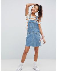 ASOS - Denim Overall Dress In Mid Wash Blue - Lyst