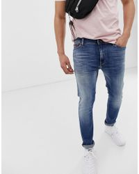 c9525b5a5 Hilfiger Denim Tommy Jeans Simon Skinny Fit In Stretch Mid Wash in ...