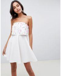 288b798219ef9 Lyst - ASOS Cross Front Halter Mesh Insert Mini Bodycon Dress in White