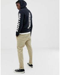 Hollister - Back/front And Sleeve Logo Hoodie In Black - Lyst