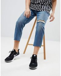 Mennace - Tapered Jeans In Midwash Blue With Knee Rip - Lyst