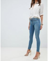 ASOS - Whitby Low Rise Skinny Jeans In Mid Stonewash Blue - Lyst