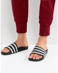 adidas Originals - Adilette Sliders In Black 280647 - Lyst