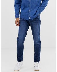 Burton Carrot Fit Jeans In Mid Wash - Blue