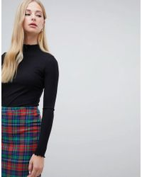 Warehouse - Ribbed High Neck Top With Lettuce Hem In Black - Lyst