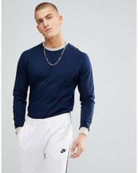 ASOS - Relaxed Long Sleeve T-shirt With Contrast Ringer And Contrast Cuff In Blue - Lyst