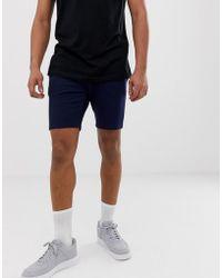 ASOS - Short ajusté en jersey - Bleu marine - Lyst