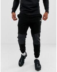 Bershka - Cuffed jogger In Black With Panels - Lyst
