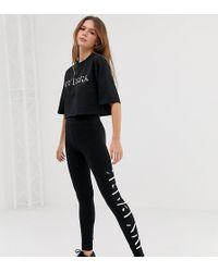 Ivy Park - Leggings neri con logo - Lyst