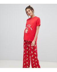 ASOS - Pijama de camiseta y pantaln con estampado navideo de pan de  jengibre de ASOS 1cfc74378f1