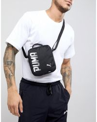 PUMA - Pioneer Flight Bag In Black 07471701 - Lyst