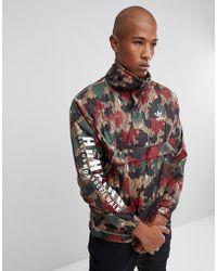 adidas Originals - X Pharrell Williams Hu Hiking Half Zip Windbreaker In Camo Print Cy7871 - Lyst