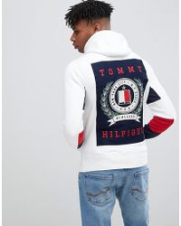 Tommy Hilfiger - Back Logo Print And Icon Sleeve Detail Full Zip Hoodie In White - Lyst