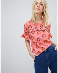 9caab7453e7ad Lyst - Mango Cold Shoulder Floral Print Top in White