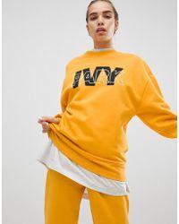 Ivy Park - Felpa gialla con logo - Lyst