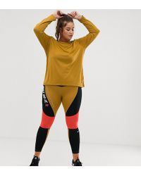 e00dd3bf698af Nike - Nike Plus Training High Waist Colourblock Leggings In Gold And Pink  - Lyst