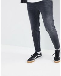 ASOS - Recycled Tapered Jeans In Washed Black - Lyst