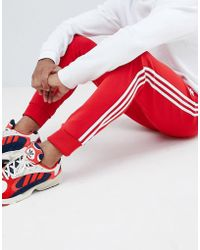 adidas Originals 3-stripe Skinny joggers With Cuffed Hem In Red Dh5837