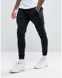 Nike Pantalon de jogging ajusté en molleton technique - Noir