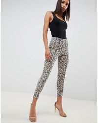 ASOS - Ridley High Waist Corset Skinny Jeans In Leopard Print With Cross Stitch Detail - Lyst