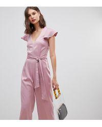 Warehouse - Tuta jumpsuit rosa con incrocio sul retro e volant sulle maniche - Lyst