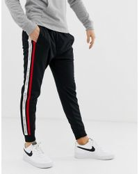 Abercrombie & Fitch - Logo Side Tape Tricot Cuffed Sweatpants In Black - Lyst