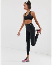 Nike - Leggings reductores en negro - Lyst
