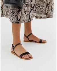 ec05cb3bfd321 Steve Madden Danny Black Leather Flat Sandals in Black - Lyst