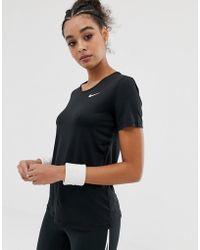 04ca8c1ecd9dd Nike Nike Plus Training Short Sleeve Mesh Panel Tee In Pink in Pink ...