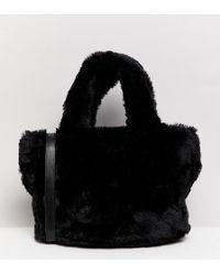 Monki - Faux Fur Hand Bag In Black - Lyst