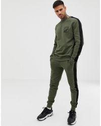ASOS - Sweat-shirt et pantalon de jogging ajust inscription et bandes  latrales - Lyst c071e5adcd13