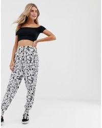 e99ad9913b0b ASOS Ultimate Jersey Harem Pants in Black - Lyst
