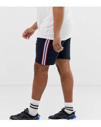 ASOS - Pantalones cortos de punto de corte slim con raya lateral en azul marino de Plus - Lyst