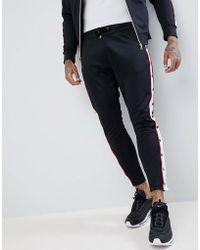 The Couture Club - Joggers ajustados negros con botones de presin de - Lyst a5c7f83ca5910