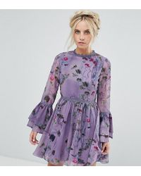 Little Mistress   All Over Floral Skater Dress With Fluted Sleeve Detail   Lyst